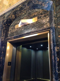 """It's hard to tell, but the indicator above the elevator doors says, """"This car up."""""""
